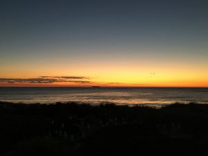 The afterglow of sun set when the sun is below the horizon. Looking west over the ocean. Photo by Barb Dobson.
