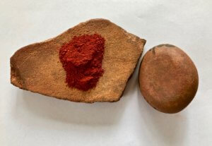 Red ochre and ochre grinding stone